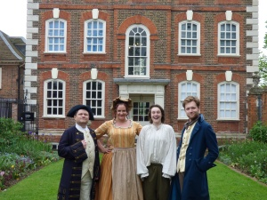 Captain Gilbert, Mrs Wiggins, Martin and Massey pose outside Rainham Hall