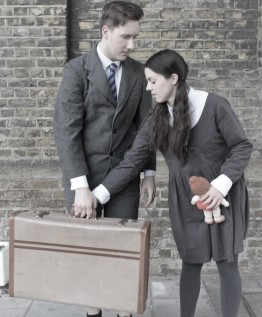 A girl takes a suitcase from a boy